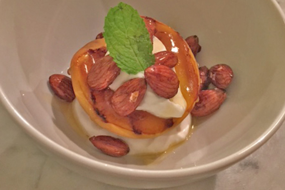 Recipe: Grilled Peaches With Vanilla Yogurt and Candied Almonds